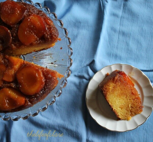 slice of peach syrup cake